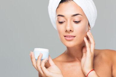 beautiful woman using skin care cream