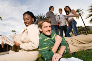 college students on campus lawn