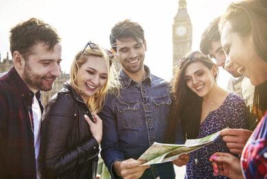 friends looking on a map in london