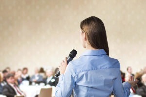 girl speaking during conference