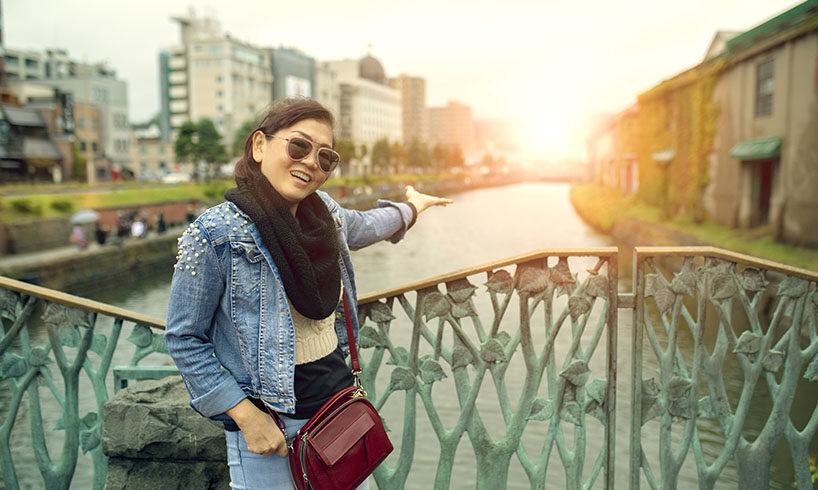happiness emotion of asian tourist