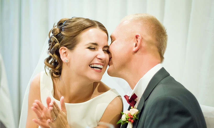 happy bride and groom laughing