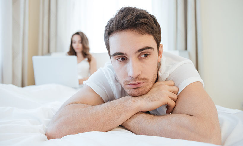 man in bed thinking about something