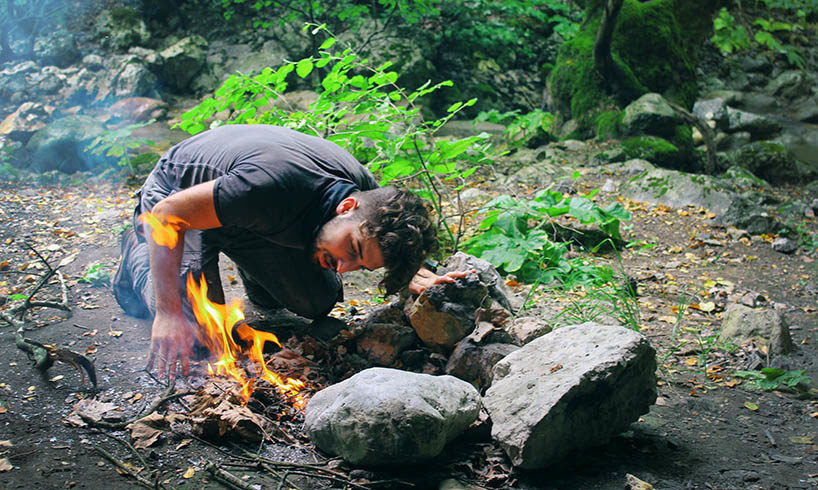 man making fire in the wood