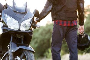 man near motorcycle
