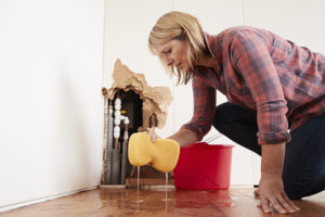 woman mopping up water